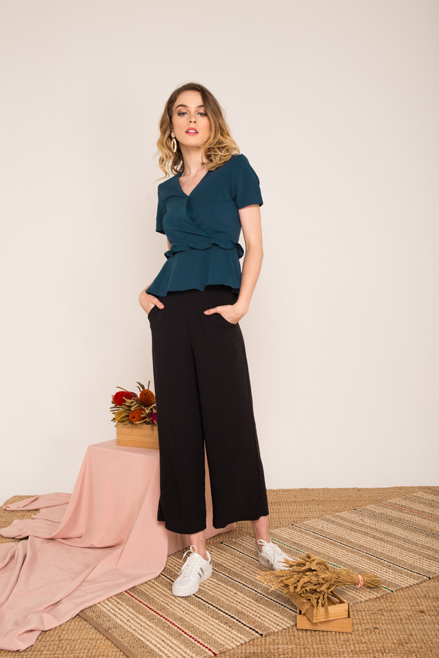 Urien High-waisted Trousers in Black