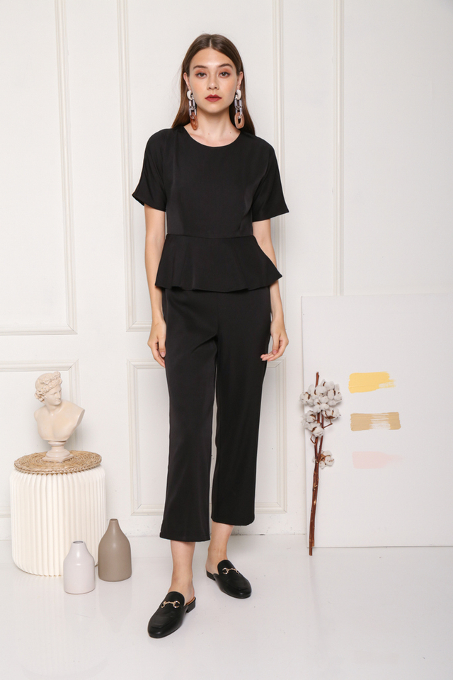 Raea Sleeved Overlay Peplum Jumpsuit in Black (XS)