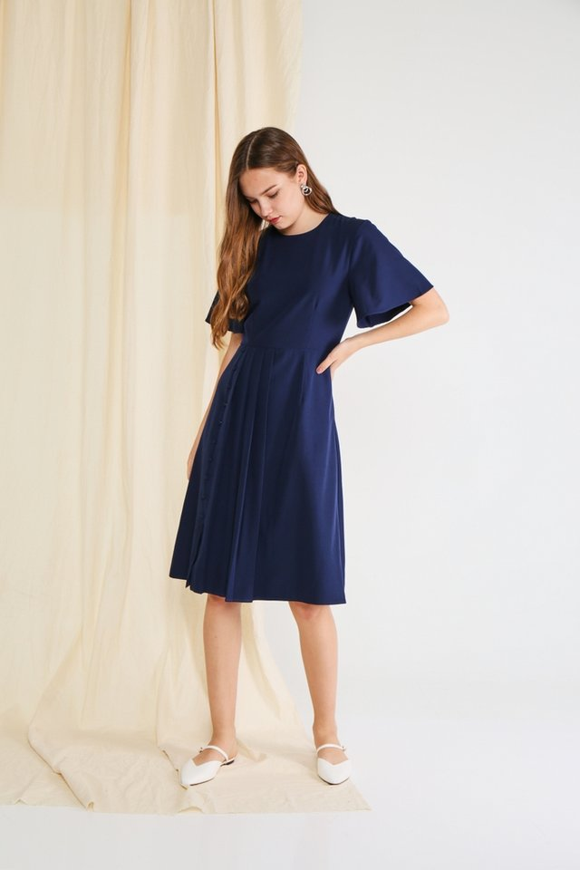 Adele Pleated Button Midi Dress in Navy (XS)