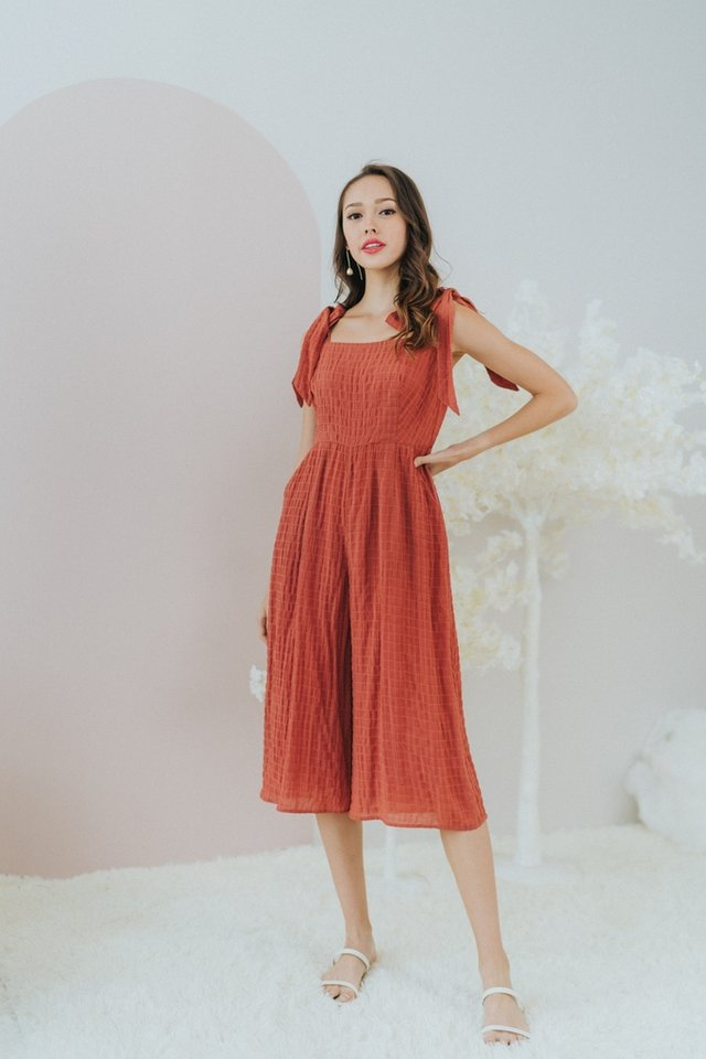 Pam Textured Ribbon Jumpsuit in Rust